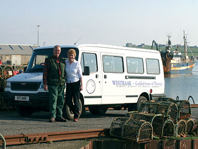 Graham and Kathy with mini-bus on Gill Pier